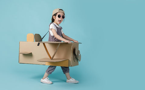 asian-little-child-girl-playing-with-cardboard-toy-airplane.jpg