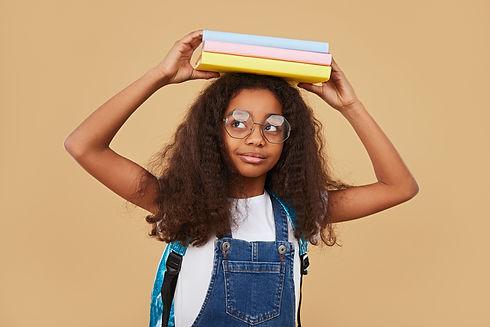 smart-black-schoolgirl-with-textbooks.jpg