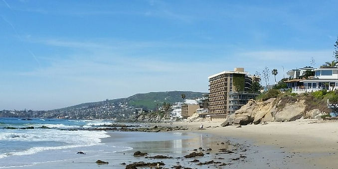 a beach with hotels along the edge