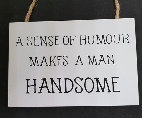 A Sense Of Humour Hanging Sign