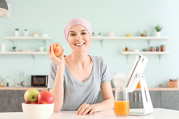 Woman after chemotherapy in kitchen at home.jpg