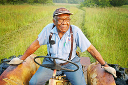 black-farmer-on-tractor