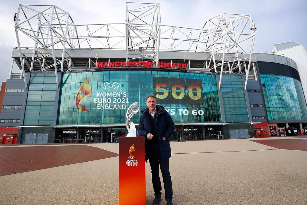 Lionesses manager Phil Neville poses with the Euro 2021 trophy outside of Old Trafford