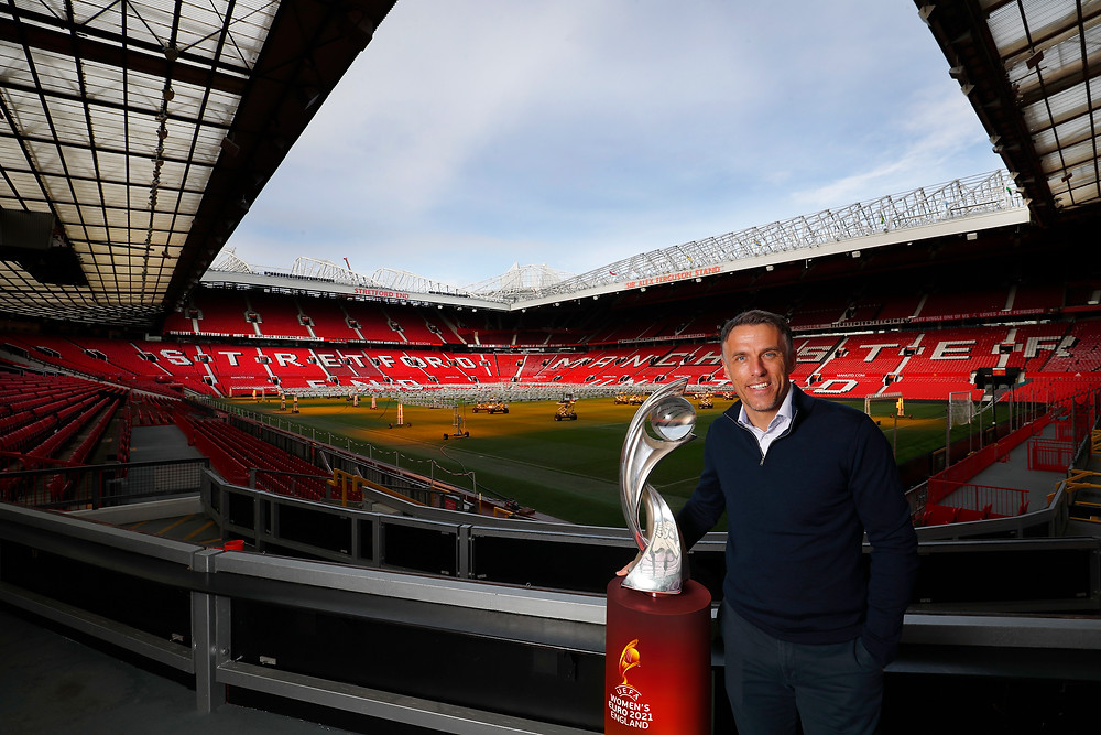 England manager Phil Neville poses with the Euro 2021 trophy at Old Trafford