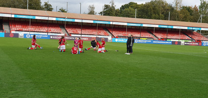 Bristol manager Tanya Oxtoby talking to the players at the People's Pension Stadium