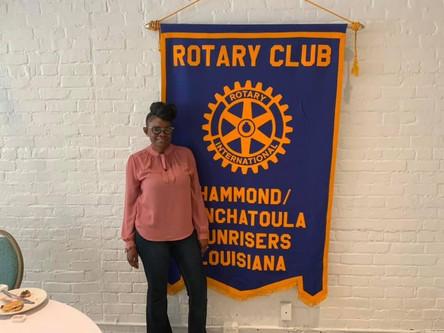 President attending Rotary Club breakfast meeting.