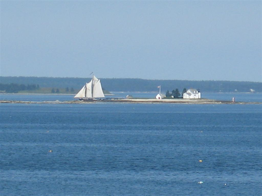 close-up of schooner & lighthouse