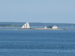 close-up of schooner & lighthouse