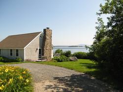 corner of cottage looking at ocean