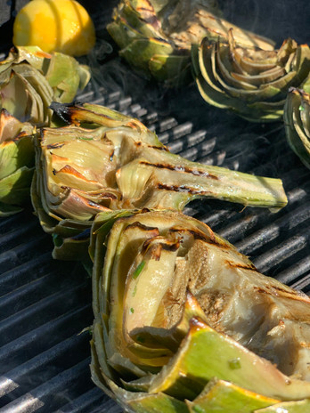 Grilled artichokes with a garlic aioli dipping sauce.