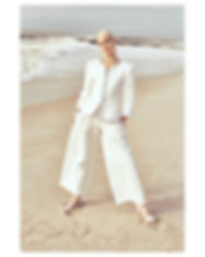 V Magazine March editorial with Taja Feistner or Feistyt at the beach wearing all white clothes fashion editorial