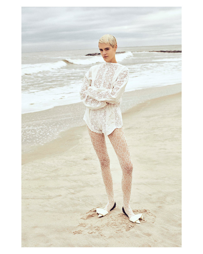 V Magazine March editorial with Taja Feistner or Feistyt at the beach wearing all white clothes wearin white stocking and point shoes