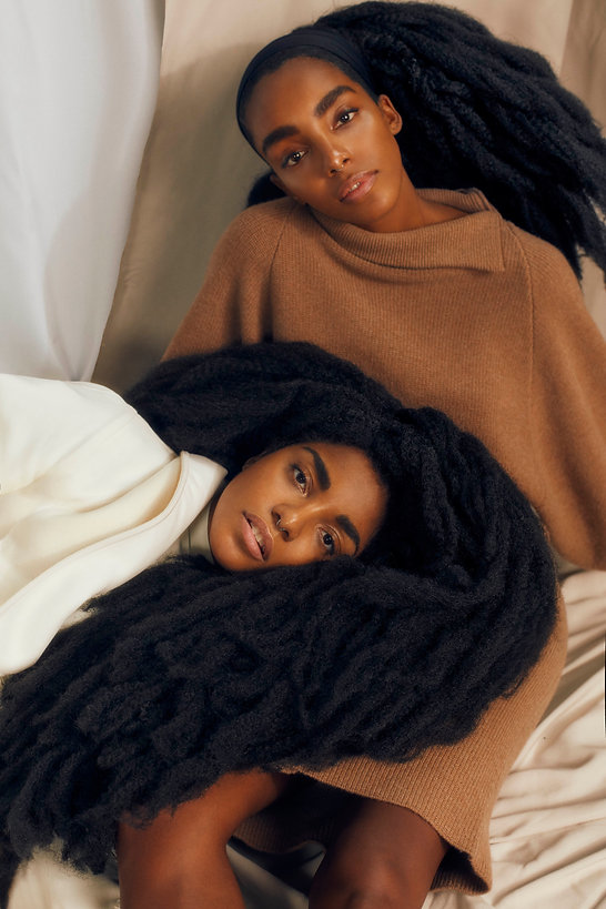 tk wonder and cipriana quann for elle magazine september issue, together laying against each other