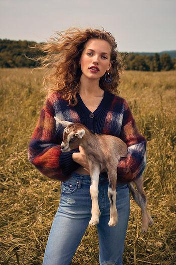 Intermix Fall 18 Campaign, Tanya Kizko holding baby goat