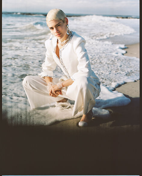 V Magazine March editorial with Taja Feistner or Feistyt at the beach wearing all white clothes wearing chanel