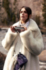 Amand Wellsh wearing Celine in snow up in the mountains of Vail Colorado all white outfit, mountain river shot portrait