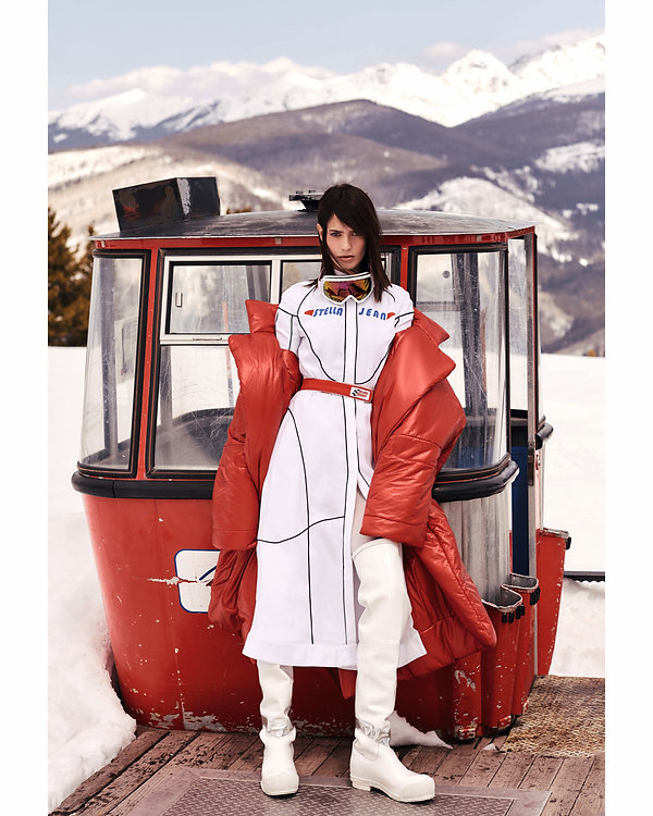 Amand Wellsh wearing Alexander Wang in snow up in the mountains of Vail Colorado, red outfit by the sky lift