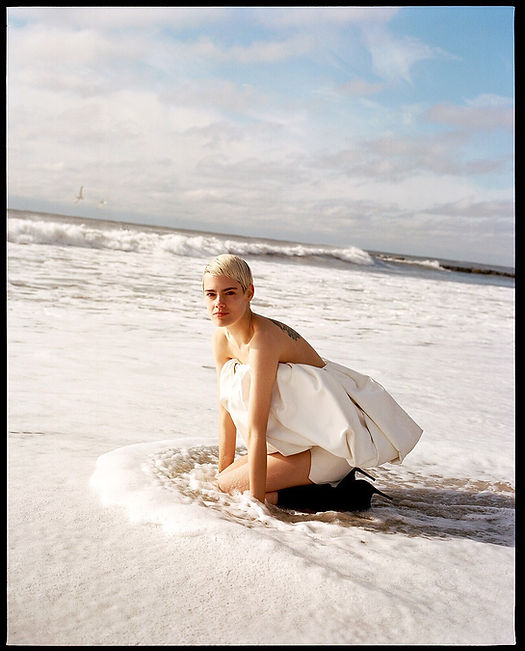 V Magazine March editorial with Taja Feistner or Feistyt at the beach wearing all white clothes wearing YSL Saint Laurent inside the water
