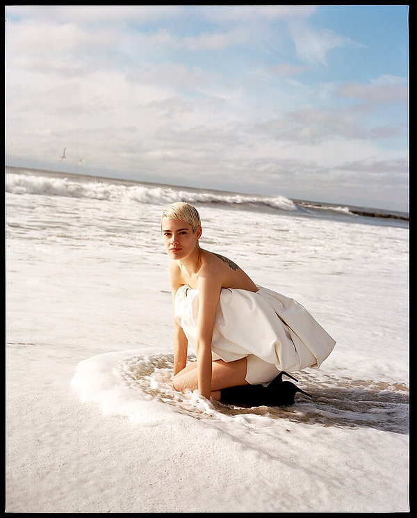 V Magazine March editorial with Taja Feistner or Feistyt at the beach wearing all white clothes