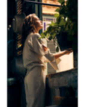 Dasha Malentina in Cuba for Elle Magazine looking outside the window