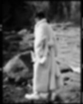 Amand Wellsh wearing Celine in snow up in the mountains of Vail Colorado all white outfit, mountain river shot film image