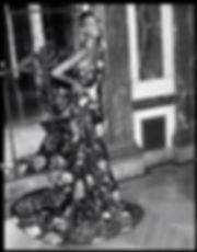 bergdorf goodman evening campaing, model mayowa nicholas wearing Marchesa dress and smiling, smile