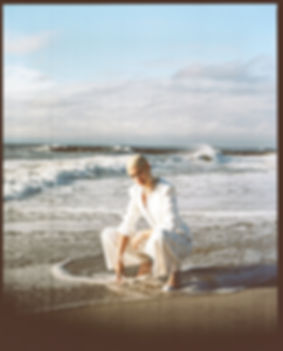 V Magazine March editorial with Taja Feistner or Feistyt at the beach wearing all white clothes by th water chanel outifit