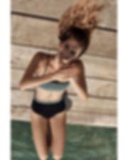 Megan Williams bikini campaign swim at the beach smiling