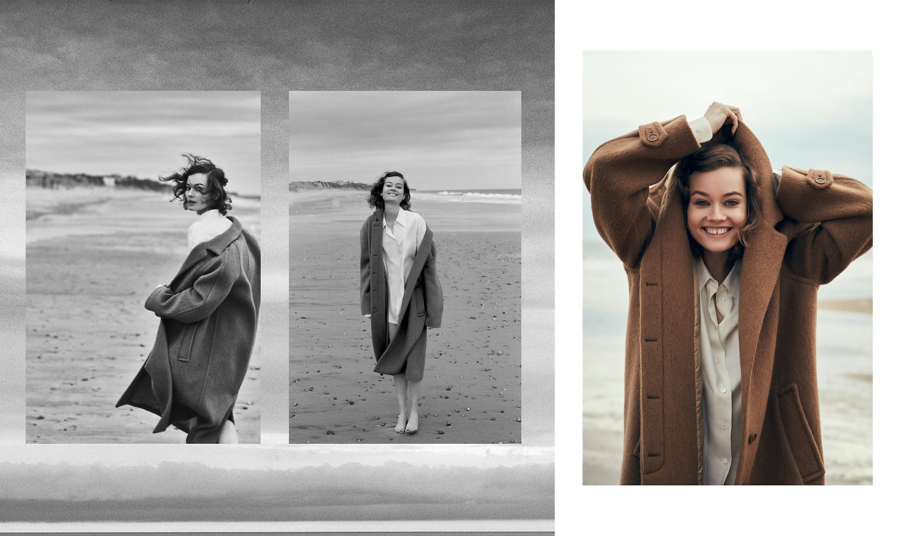 Jac Monika wearing a oversized jacket from Celine at the beach in Montauk, happy and smiling. Smiles