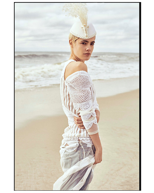 V Magazine March editorial with Taja Feistner or Feistyt at the beach wearing all white clothes with a hat and jeans