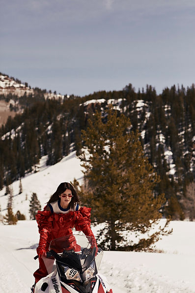 Amand Wellsh wearing Pucci in snow up in the mountains of Vail Colorado fashion editorial driving snow mobile