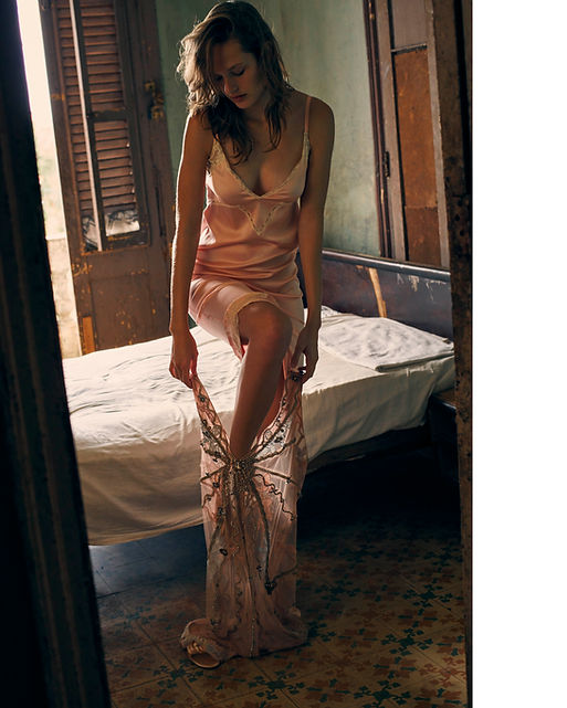 Dasha Malentina in Cuba for Elle Magazine dressin up sexy in the apartment