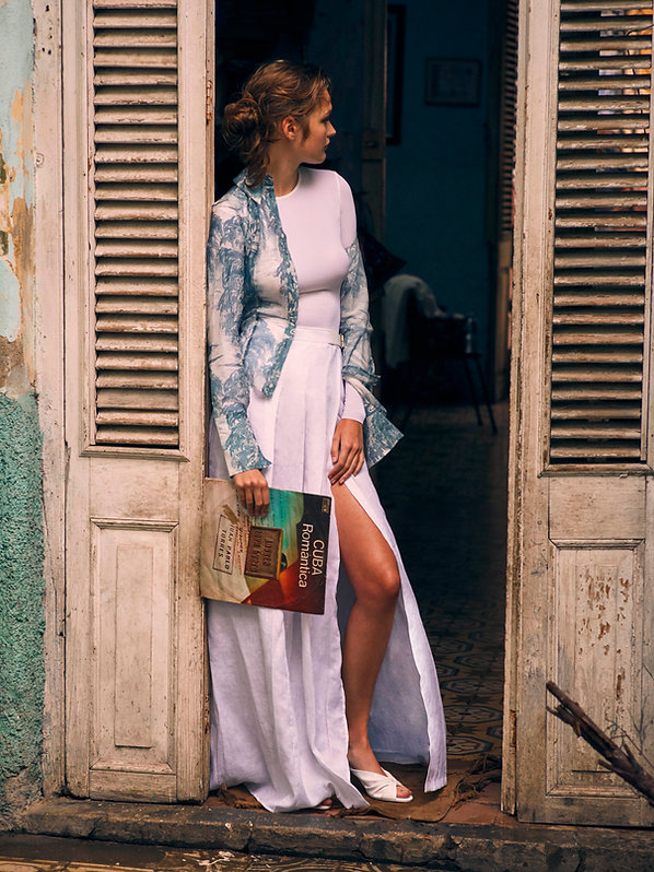 Dasha Malentina in Cuba for Elle Magazine fashion shoot with vinyl cuba romantica