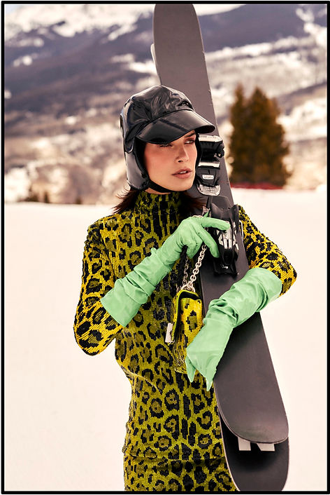 Amand Wellsh wearing Tom Ford in snow up in the mountains of Vail Colorado, with skiis and sking fashion editorial