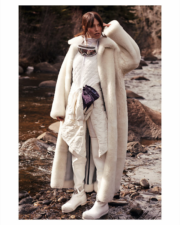 Amand Wellsh wearing Celine in snow up in the mountains of Vail Colorado all white outfit, mountain river shot