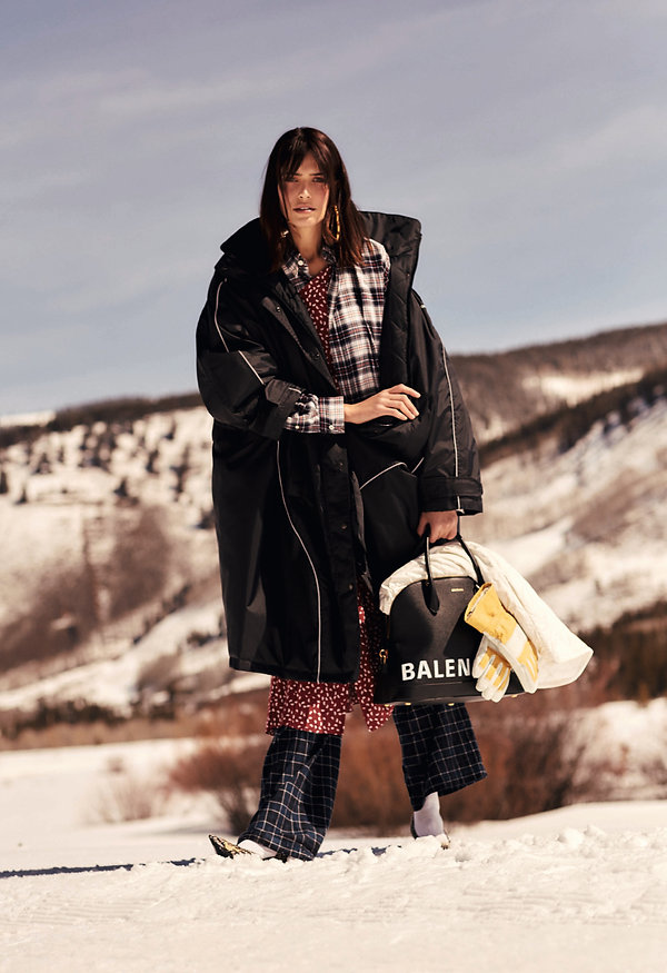 Amand Wellsh wearing Balenciaga in snow up in the mountains of Vail Colorado, walking on the snow full fashion editorial