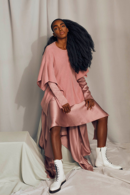 cipriana quann seating in pink clothes for elle brazil september issue