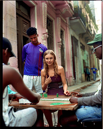 Viva La Revolucion - Will Vendramini - Elle magazine with brooke perry shot in Havana Cuba Playing Domino with strangers