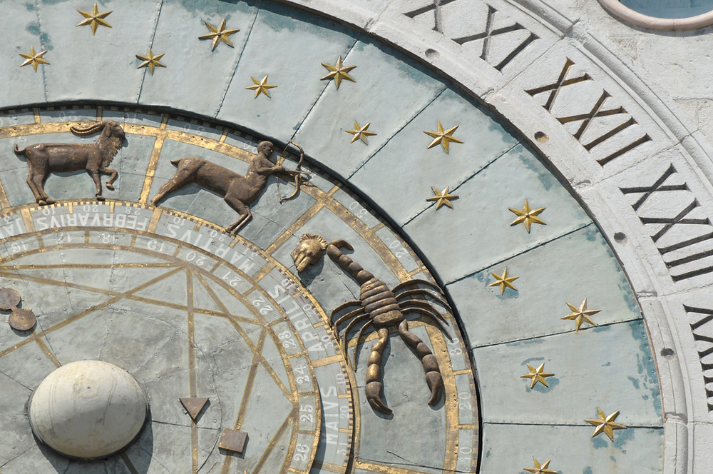 astronomical clock showing centaur and scorpio