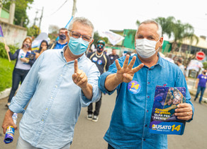 Busato e Dario fazem caminhada com apoiadores em busca da vitória na eleição