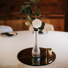 Silver vase, faux rose and eucalyptus, circle mirror and gold votive