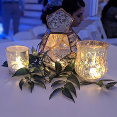 Mercury candle holders with greenery