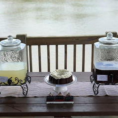 Beveled glass drink dispensers on stands