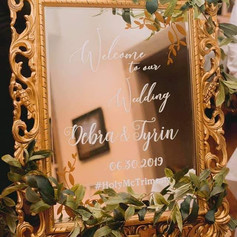 Ornate mirror with vinyl message, with greenery and easel