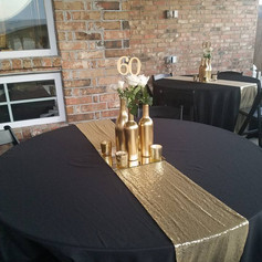 Gold wine bottles with choice of flowers, and mercury votives