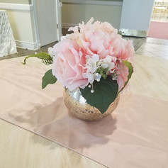 Faux blush flowers in mercury vase