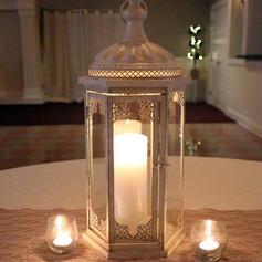 Antique white lantern with votives