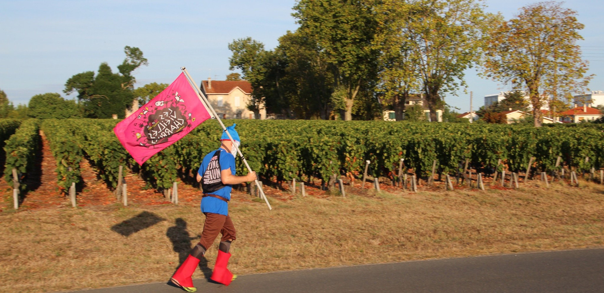 Flag-Bearing Runner at the Marathon du Medoc