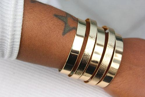 Vela gold cuff bangle