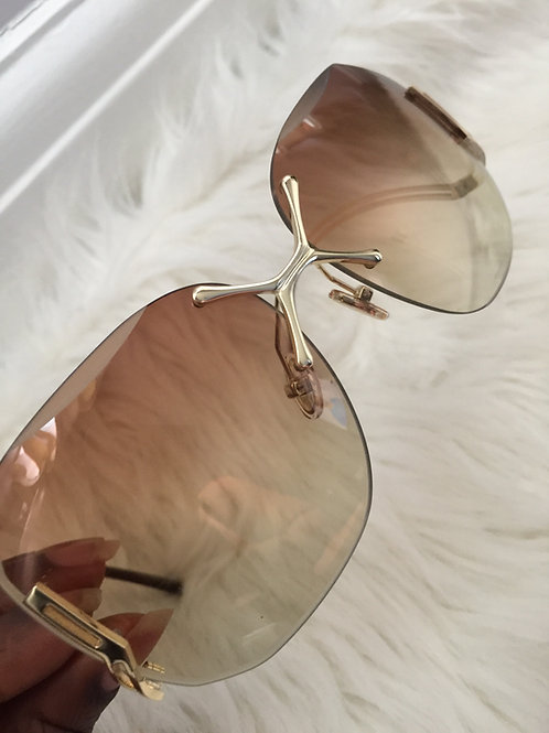 Sandy reversed curve brown glasses